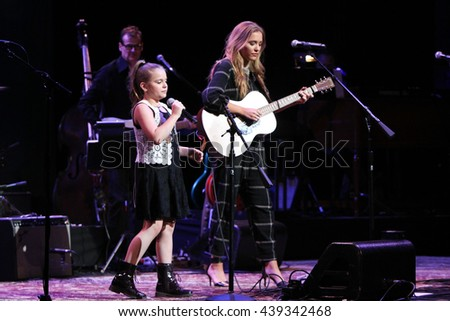 NEW YORK-APR 30: Maisy Stella (L) and Lennon Stella perform onstage during the 'Nashville' Tour at The Beacon Theatre on April 30, 2015 in New York City. - stock photo