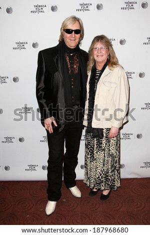 NEW YORK-APR 17: Musician Neal Smith (L) and Rose Smith attend the 'Super Duper Alice Cooper' premiere at Chelsea Bow Tie Cinemas on April 17, 2014 in New York City. - stock photo