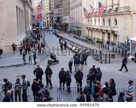 NEW YORK - APR 13: Police guard the New York Stock Exchange, April 13, 2012 in New York City, NY. Nearby, Occupy Wall Street protesters held a demonstration against the financial system. - stock photo