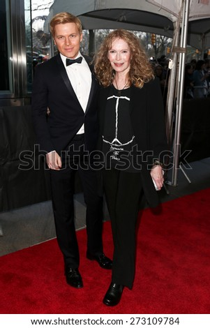 NEW YORK-APR 21: Ronan Farrow (L) and mother Mia Farrow attend the 2015 Time 100 Gala at Frederick P. Rose Hall, Jazz at Lincoln Center on April 21, 2015 in New York City. - stock photo