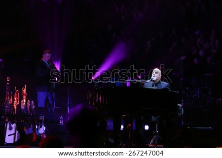 NEW YORK-APR 3: Singer/songwriter Billy Joel performs in concert at Madison Square Garden on April 3, 2015 in New York City. - stock photo