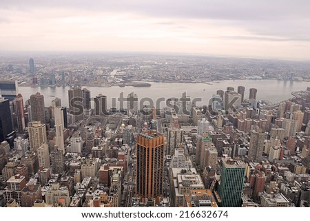 NEW YORK - APRIL 10: A captivating aerial view of Manhattan skyscrapers and buildings from the top of the Empire State Building on April 10, 2011. New York City has well over nine million residents. - stock photo