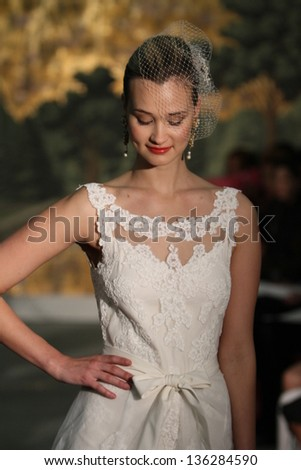 NEW YORK - APRIL 21: A model walks runway for Anne Barge bridal show at The London Hotel during Bridal Fashion Week on April 21, 2013 in New York City