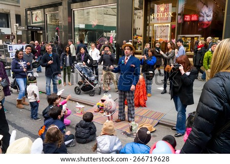 NEW YORK - APRIL 5:  A Puppeteer entertains a group of children on the street during The 2015 Easter Parade and Easter Bonnet Festival in New York City - stock photo