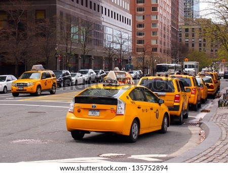 NEW YORK - APRIL 20: A taxi line in Battery Park City, Manhattan, April 20, 2013 in New York City. The city is planning to replace its fleet of various kinds of taxis with one model. - stock photo