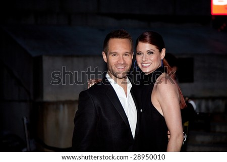 NEW YORK - APRIL 21: Actor Chris Diamantopoulos and actress Debra Messing pose for photographers at Vanity Fair party for the 2009 Tribeca Film Festival April 21, 2009 in New York.