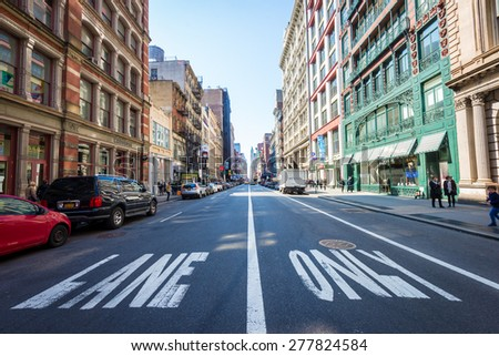 "NEW YORK - APRIL 5, 2015: Broadway shops in SOHO in New York City early morning.  The acronym SOHO stands for ""South of Houston St,"" which is famous for its shopping. - stock photo"