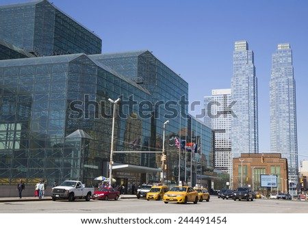 NEW YORK - APRIL 24, 2014: Javits Convention Center in Manhattan. The convention center has a total area space of 1,800, 000 square ft and has 840,000 square ft of total exhibit space  - stock photo