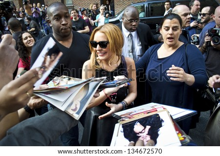 NEW YORK - APRIL 9: Lindsay Lohan greets fans after her David Letterman appearance outside the Ed Sullivan Theater on April 9, 2013 in Manhattan. - stock photo