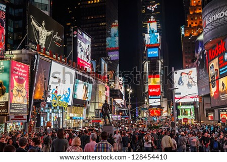 NEW YORK - APRIL 17, 2012: Night traffic across Times square on April 17,2012 in New York City. Times Square is the most visited tourist attraction in the world with over 39 million visitors annually. - stock photo