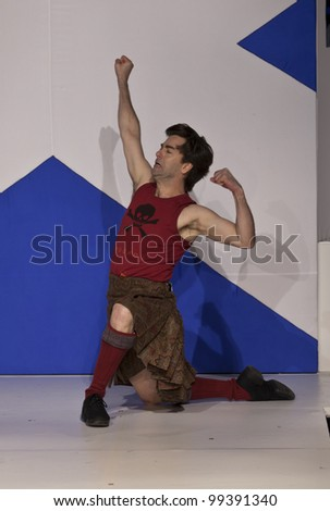 NEW YORK - APRIL 02: Principal dancer of New York City Ballet Tom Gold dances in Glensia kilt on  runway at fashion show From Scotland With Love at The Liberty Theatre on April 2 2012 in New York City