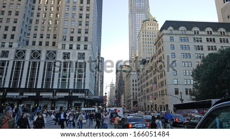 NEW YORK APRIL 5: the crowds walk in Fifth Avenue in New York on 5 april 2012. Fifth avenue is one of famous street in new york - stock photo