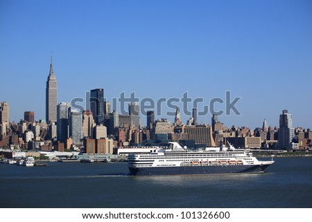 NEW YORK - APRIL 29: The cruise ship Veendam passes the Manhattan skyline on April 29, 2012 in New York. The ship has 633 cabins and a crew of over 600. - stock photo
