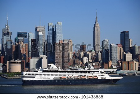 NEW YORK - APRIL 29: The cruise ship Veendam passes the Manhattan skyline on April 29, 2012 in New York. The ship has 633 cabins and crews of over 600. - stock photo