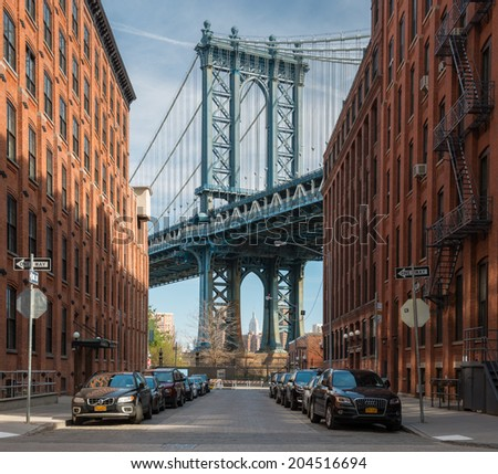 NEW YORK - APRIL 20:The Manhattan Bridge is a suspension bridge that crosses the East River in New York City,USA,on April 20, 2014.The bridge's total length is 6,855 ft (2,089 m) - stock photo