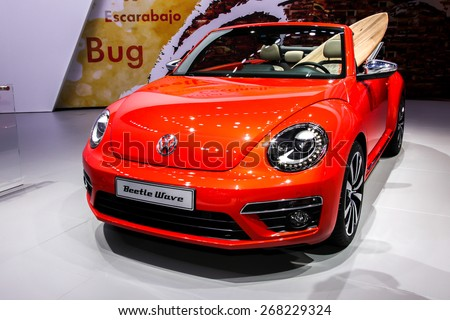 NEW YORK - APRIL 1: Volkswagen exhibit before Volkswagen Beetle wave at the 2015 New York International Auto Show during Press day,  public show is running from April 3-12, 2015 in New York, NY. - stock photo