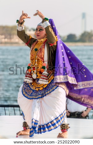 New York - Aug 20: A woman with costume and make-up performs a traditional indian dance at a cultural show on August 20, 2014 at Battery Park, New York, USA. - stock photo
