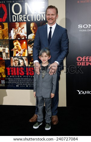 NEW YORK-AUG 26: Director Morgan Spurlock (top) and son Laken attend the New York premiere of 'One Direction: This Is Us' at the Ziegfeld Theater on August 26, 2013 in New York City. - stock photo