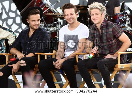NEW YORK - AUG 4: Liam Payne, Louis Tomlinson and Niall Horan of One Direction perform on 'Good Morning America' in Central Park on August 4, 2015 in New York City. - stock photo