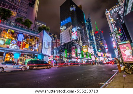 NEW YORK - AUG 10, 2015: Manhattan street view at night in New York City with light beams of traffic.