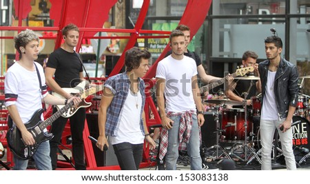 NEW YORK - AUG 23: Niall Horan, Harry Styles, Liam Payne and Zayn Malik of One Direction performs on NBC's Today Show at Rockefeller Plaza on August 23, 2013 in New York City. - stock photo