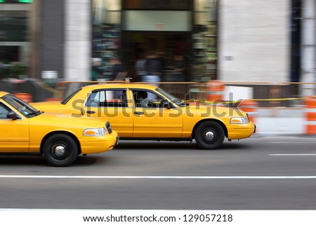 NEW YORK - AUG 9: Yellow NYC taxi cab in New York City on August 9, 2011. The taxicabs of New York City are a widely recognized icon of the city. - stock photo
