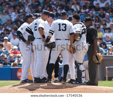 NEW YORK: AUGUST 17 - A Yankee team talk on the mound at Yankee Stadium on August 17, 2008. - stock photo