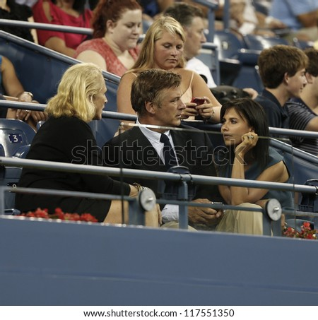 NEW YORK - AUGUST 27: Alec Baldwin and Hilaria Thomas attend opening ceremony at US Open tennis tournament on August 27, 2012 in Flushing Meadows New York - stock photo