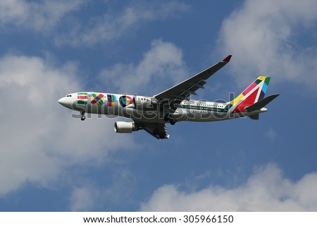 NEW YORK - AUGUST 13, 2015: Alitalia Airbus A330 with Milano 2015 Expo livery  descending for landing at JFK International Airport in NY. Alitalia is the Official Global Airline Carrier of EXPO Milano - stock photo