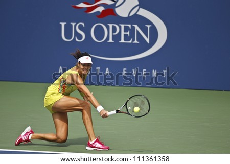 NEW YORK - AUGUST 28: Ana Ivanovic of Serbia returns ball during 1st round match against Elina Svitolina of Ukraine at US Open tennis tournament on August 28, 2012 in Flashing Meadows New York - stock photo