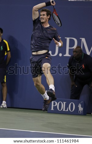 NEW YORK - AUGUST 29: Andy Murray of United Kingdom returns ball during 2nd round match against Ivan Dodig of Croatia at US Open tennis tournament on August 29, 2012 in Flashing Meadows New York - stock photo
