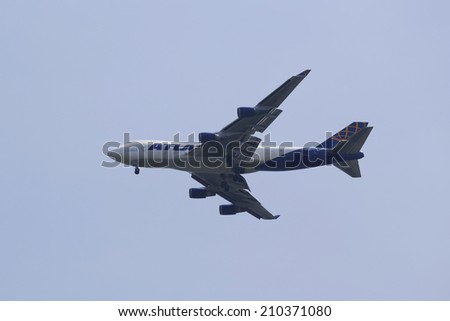 NEW YORK - AUGUST 10: Atlas Air Boeing 747 operated for Qantas Freight in New York sky before landing at JFK Airport on August 10, 2014. Atlas Air is an American cargo and passenger charter airline - stock photo