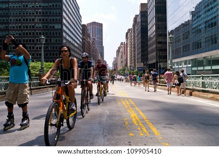 NEW YORK - AUGUST 11:  Bicyclist, joggers and walkers enjoy Car Free Streets on Park Ave as part of New York City's Summer Streets August 11, 2012 in New York City. - stock photo