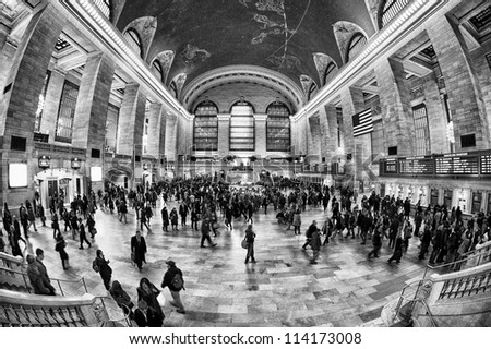NEW YORK, AUGUST 24: commuters and tourists in the grand central station in August 24, 2012 in New York, NY. It is the largest train station in the world by number of platforms: 44, with 67 tracks - stock photo