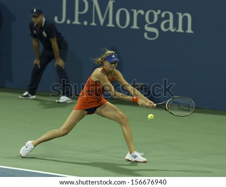 NEW YORK - AUGUST 29: Daniela Hantuchova of Slovakia returns ball during 2nd round match against Victoria Duval at 2013 US Open at USTA Tennis Center on August 29, 2013 in New York - stock photo
