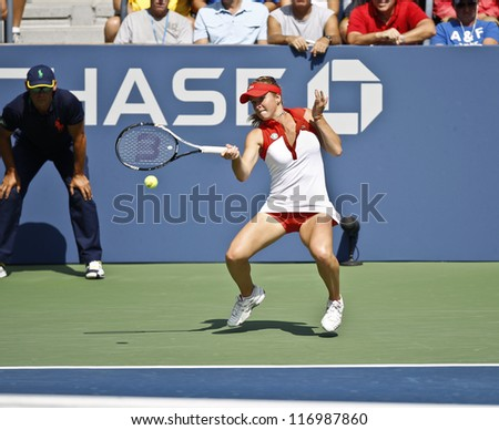 NEW YORK - AUGUST 28: Elina Svitolina of Ukraine returns ball during 1st round match against Ana Ivanovic of Serbia at US Open tennis tournament on August 28, 2012 in Flushing Meadows New York