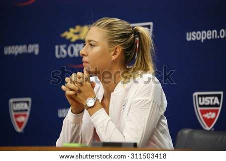 NEW YORK - AUGUST 30, 2015:Five times Grand Slam Champion Maria Sharapova during press conference before US Open 2015. Next day Maria withdraws from US Open with leg injury.  - stock photo