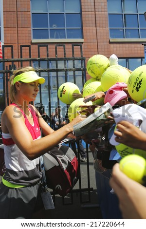 NEW YORK - AUGUST 28 Five times Grand Slam champion Maria Sharapova signing autographs after practice for US Open 2014 at Billie Jean King National Tennis Center on August 28, 2014 in New York  - stock photo