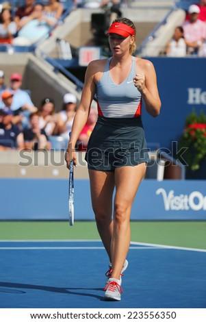 NEW YORK- AUGUST 31: Five times Grand Slam champion Mariya Sharapova during third round match at US Open 2014 against Caroline Wozniacki at Arthur Ashe stadium on August 31, 2014 in New York  - stock photo