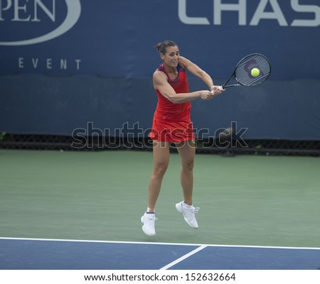 NEW YORK - AUGUST 31: Flavia Pennetta of Italy returns ball during 3rd round match against Svetlana Kuznetsova of Russia at 2013 US Open at USTA Billie Jean King Tennis Center on August 31 2013 in NYC