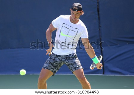 NEW YORK - AUGUST 27, 2015: Fourteen times Grand Slam Champion Rafael Nadal of Spain practices for US Open 2015 at Billie Jean King National Tennis Center in New York - stock photo