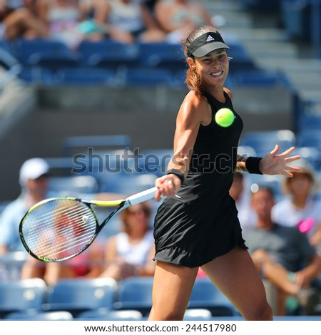 NEW YORK - AUGUST 26, 2014: Grand Slam Champion Ana Ivanovic from Serbia during US Open 2014 first round match against Alison Riske at Billie Jean King National Tennis Center in New York  - stock photo