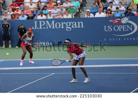 NEW YORK -  AUGUST 28: Grand Slam champions Serena Williams and Venus Williams during doubles match at US Open 2014 at National Tennis Center on August 28, 2014 in New York  - stock photo