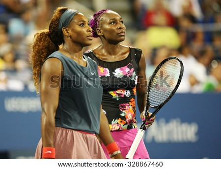 NEW YORK - AUGUST 29, 2013: Grand Slam champions Serena Williams and Venus Williams during their first round doubles match at US Open 2013 at Billie Jean King National Tennis Center in New York - stock photo