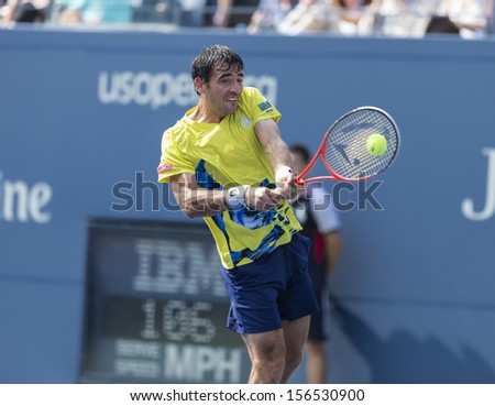 NEW YORK - AUGUST 31: Ivan Dodig of Chroatia returns ball during 3rd round match against Rafael Nadal of Spain at 2013 US Open at USTA Billie Jean King Tennis Center on August 31, 2013 in New York - stock photo
