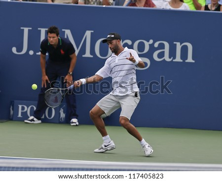 NEW YORK - AUGUST 27: James Blake of USA returns ball during 1st round match against Lukas Lacko of Slovakia at US Open tennis tournament on August 27, 2012 in Flushing Meadows New York