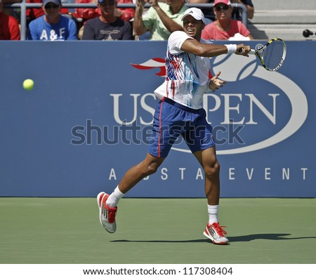 NEW YORK - AUGUST 28: Jo-Wilfried Tsonga returns ball during 1st round match against Karol Beck of Slovakia at US Open tennis tournament on August 28, 2012 in Flushing Meadows New York