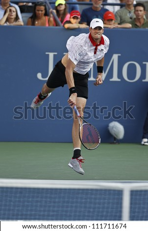 NEW YORK - AUGUST 31: John Isner of USA returns ball during 2nd round match against Jarkko Nieminen of Finland at US Open tennis tournament on August 31, 2012 in Flashing Meadows New York