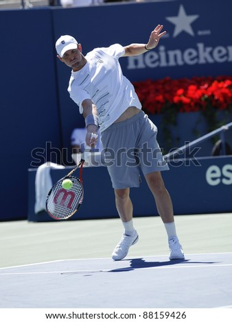 NEW YORK - AUGUST 29: Mardy Fish of USA returns ball during 1st round match against Tobias Kamke of Germany at USTA Billie Jean King National Tennis Center on August 29, 2011 in NYC