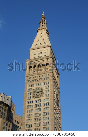 NEW YORK - AUGUST 1, 2015: Met Life Tower with iconic clock in Flatiron district in Manhattan. Clock face is 26.5 feet (8 m) in diameter with each number being four feet (1.2 m) tall - stock photo